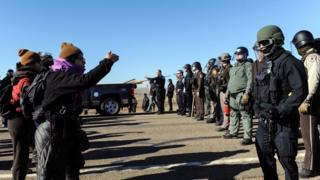 Police face people protesting against the Dakota Access pipeline