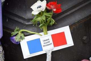 Flower and note left after Paris attacks