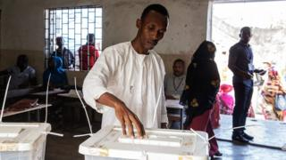 A man casts his ballot for the presidential election at a polling station of Mitsoudje
