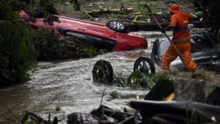 in_pictures A rescuer works in Realengo neighbourhood, in the suburbs of Rio de Janeiro, Brazil. Photo: 2 March 2020