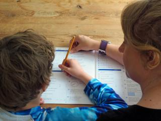 William and his mother Caroline practising Maths