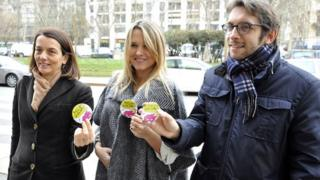 Francesca Barra (centre) holds one of the new badges