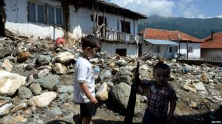 Boys stand on a street in the flooded village of Sipkovica, near the town of Tetovo, Macedonia, 4 August 2015