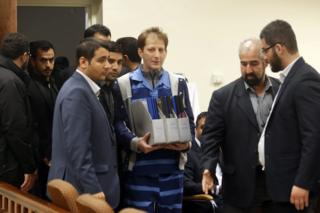 Babak Zanjani (centre) arrives for trial in Tehran, 1 November 2015