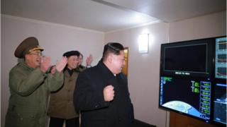 North Korea's leader, Kim Jong-un, watches he missile launch on 29 November