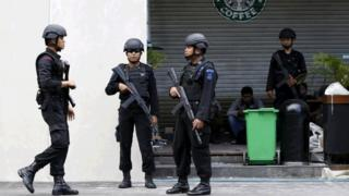 Indonesian police stand guard at the site of a militant attack in central Jakarta, Indonesia in this January 16, 2016