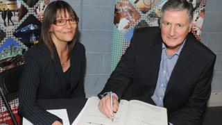 Jim Platt (right) signs the declaration of the acceptance of office in the company of Middlesbrough Council's head of legal services, Samantha Dorchell, following his election