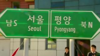 Signposts to capitals of North and South Korea