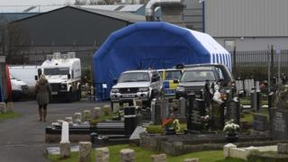 Police at scene of exhumation of Daniel Rooney's body