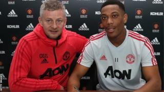 Manchester United interim boss Ole Gunnar Solskjaer with forward Anthony Martial