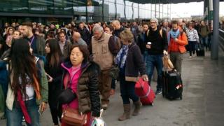 Passengers being evacuated from the north terminal at Gatwick Airport.