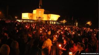 A candlelight procession outside Knock basilica during its annual Novena