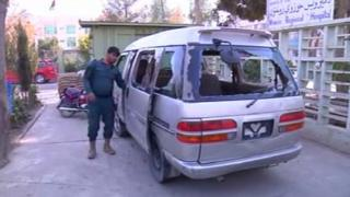 The minivan that was attacked by gunmen while carrying five female security staff at Kandahar airport