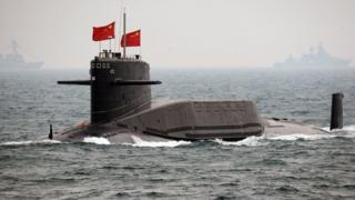 A Chinese Navy submarine attends an international fleet review to celebrate the 60th anniversary of the founding of the People's Liberation Army Navy on 23 April 2009, off Qingdao in Shandong Province.