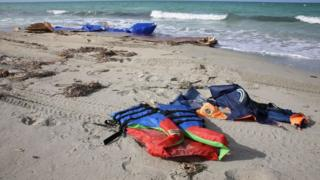 Life jacket ontop beach for Libya