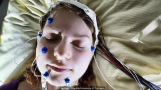Woman with electrodes on her head