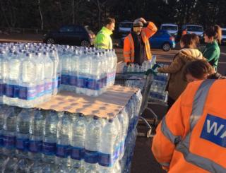 Bottled water being distributed
