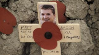 Cross for Matt Bacon with poppy and picture and the date of his death, 11 September 2005