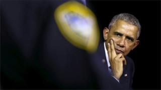 U.S. President Barack Obama listens to remarks while hosting a community discussion on drug addiction during a visit to Charleston, West Virginia October 21, 2015.