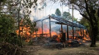 A Rohingya village which was burnt on 7 September - Ms Suu Kyi said violence had stopped before then