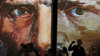 """Visitors at the multimedia exhibition """"Van Gogh Alive - The Experience"""" in Krakow"""