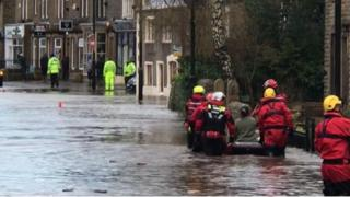 Resident rescued on an inflatable boat