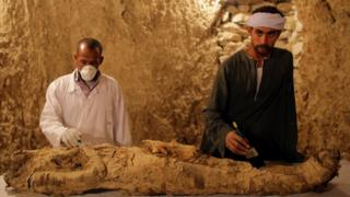 Archaeologists work on a mummy at a tomb at Draa Abul Naga necropolis on Luxor's west bank, 700km south of Cairo, Egypt, 09 December 2017.