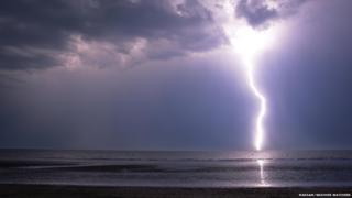 Single lightning bolt over the sea