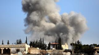 Smoke rises from the village of Khan al-Assal in Syria's Aleppo province after a reported Syrian government air strike (22 January 2020)