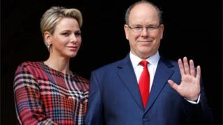 Prince Albert II of Monaco and his wife Princess Charlene stand on the palace balcony in Monaco on 27 January 2018
