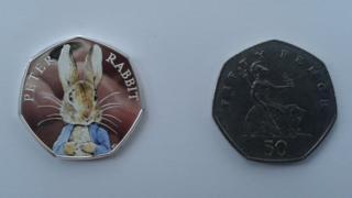 Peter Rabbit coin next to normal 50p