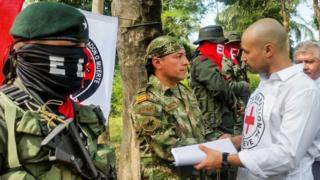 Soldier Freddy Moreno shakes hands with a Red Cross delegate before his release in Arauca