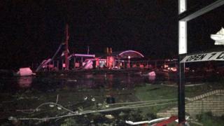 Damage is seen on a street after a tornado in Jefferson City, Missouri