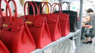 File image of luxury handbags on a shelf