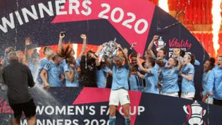 Manchester City celebrating with the FA Cup trophy at Wembley