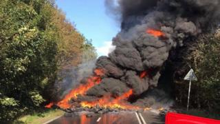 Tyres on fire in the road