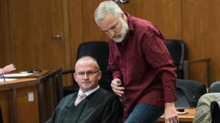Daniel Moser (R) in court, 18 Oct 17