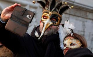 in_pictures A masked couple takes a selfie during Carnival celebrations