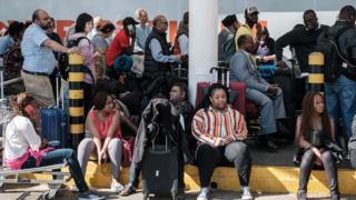 Passengers are blocked from entering Kenya Airways's departure terminal due to a strike by the airline workers at the Jomo Kenyatta International Airport in Nairobi on March 6, 2019