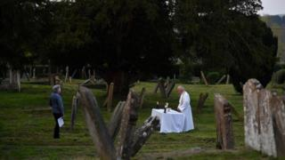 The Vicar of Brenchley conducts an Easter service to one person