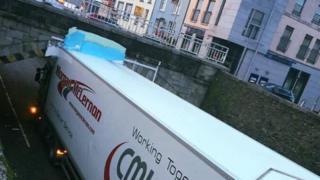 Lorry collides with bridge