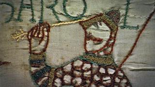 The tapestry shows a soldier being killed by an arrow in his eye, which could be King Harold