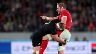 Alun Wyn Jones tackled by Sam Cane