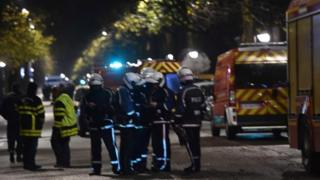 Police cordon off the area close to where armed men have taken hostages in the northern French town of Roubaix
