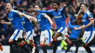 Rangers players celebrate after beating Celtic in a penalty shoot out