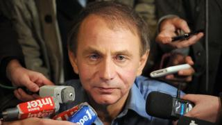 Michel Houellebecq surrounded by journalists after receiving the 2010 Goncourt Prize