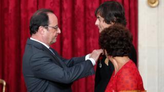 France's President Francois Hollande gives the Legion d'honneur award to Mark Moogalian at the Elysee Palace on 22 September