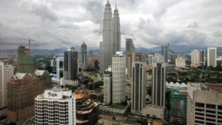 Photo shows the Petronas Twin Towers amongst the skyline of Kuala Lumpur 12 April 2005