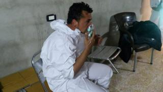A man breathes through an oxygen mask after suspected gas attack in Khan Sheikoun