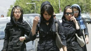 Iranian women in veils walk outside a shopping centre in Tehran on 2 June 2005